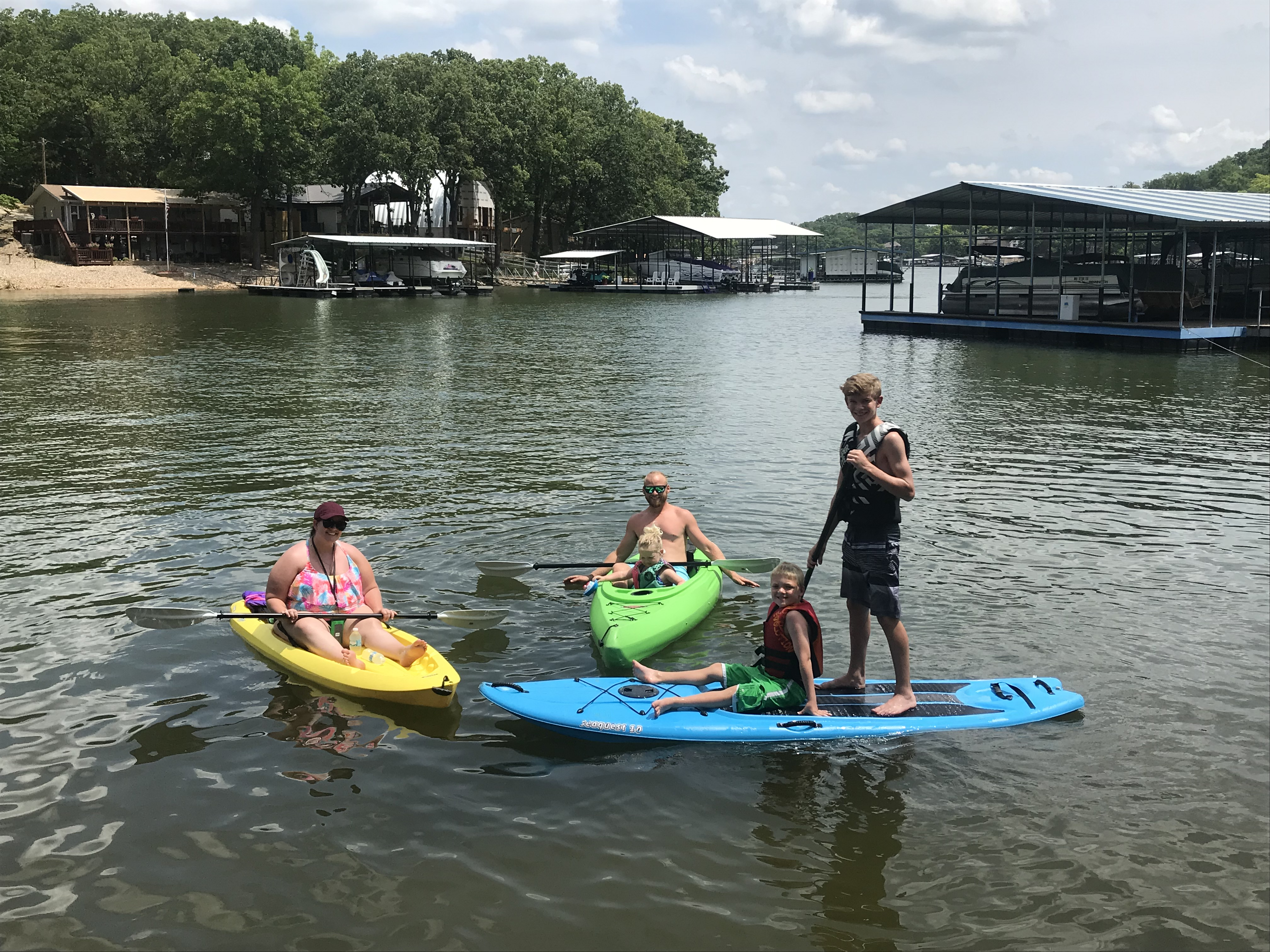 Family kayak and paddle boarding outing